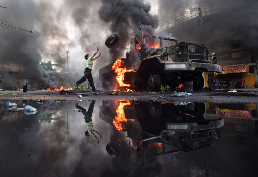 A military truck burns in occupied Bangkok, 2010.
